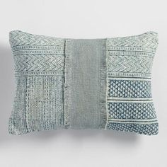 Crafted in India, our stonewashed lumbar pillow embodies the style of traditional dhurrie rugs with a patchwork of blue and green patterns, gorgeous textured fringe detail and a green back.
