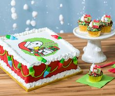 """Say """"Happy Holidays"""" with Snoopy. Learn to make this festive Peanuts cake and cupcakes."""