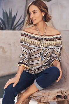 An exotic mix of patterns and hues reminiscent of the Sahara give this off-the-shoulder top its safari influence.