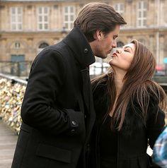 Kourtney Kardashian gets romantic on a bridge with Scott Disick as Mason plays in Paris on November 12, 2012.
