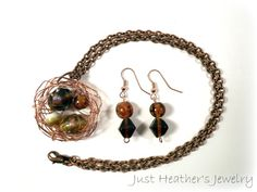 $38 - www.etsy.com/shop/JustHeathersJewelry - Copper bird's nest necklace & matching earrings - crinkled wire wrapped - unique copper beads - OOAK - birdnest - robin's - gift idea. Use coupon code PINS15 for 15% off your total purchase.