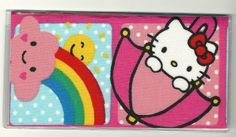 "Hello Kitty Umbrella and Rainbow Squares Checkbook Cover . $5.00. The sturdy clear VINYL COVER encases a fabric bonded design. Measuring 6 1/4"" x 3 1/4"",  the cover fits all standard bank checkbooks.  All checkbook covers come with a register flap and a duplicate check flap  just like the bank, only flashier."