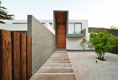 3-Element House / Tomás Swett love the gravel yard and clean lines!