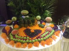 Looking for some ideas for wedding carving arrangements. See the lovely vegetable and fruit carving displays created by Saada Al -Taie for weddings. Fruit Presentation, Fruit And Vegetable Carving, Fruit Carvings, Some Ideas, Food Design, Fruits And Vegetables, Table Decorations, Play, Create