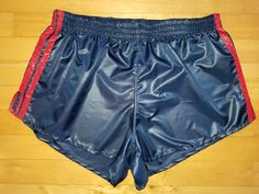 Shiny navy blue shorts with red trim and side slits