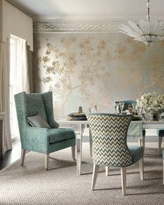 Posh Plate Special: This maximalist dining room has stunning Chinoiserie wallpaper, plus chairs upholstered in two contrasting fabrics, one a multi-color chevron stripe and the other teal velvet, plus host and hostess wing chairs in a marbleized jacquard fabric.