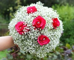 Brides Baby's breath and deep pink roses bouquet by Scent a Posy