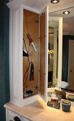 build something like this right over the plugs in both upstairs bathrooms so the hair accessories stay plugged in but concealed in a cabinet! Leave a spot for the cord for the hair accessory to be plugged-in but still used outside the cabinet while the cabinet is closed.