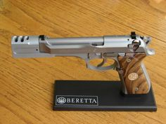 Beretta 92 with supressor.Find our speedloader now! http://www.amazon.com/shops/raeind