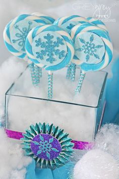 Blue and white swirled lollipops at a Frozen girl birthday party! See more party ideas at CatchMyParty.com!