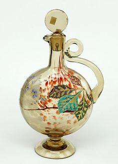 A Moser Enameled Glass Perfume Bottle. :  Amber and red mottled glass bottle bears applied enamel and gilt decoration.