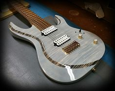 Kiesel Guitars Carvin Guitars Incredible A7H (New Aries Model) in translucent whote top and body with a deep binding effect on bevel with Zebrawood fretabord and Kiesel lithium pick ups with a hipshot bridge!