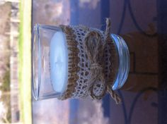 Votive candles decorated with burlap, lace and twine.