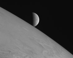 The icy moon Europa rising above Jupiter�019s cloud tops. The picture was one of a handful of the Jupiter system that New Horizons took primarily for artistic, rather than scientific, value.