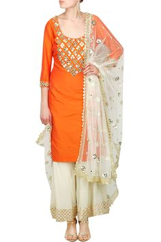 Featuring an orange scoop neck straight kurta in cotton silk with mirror work on yoke. It comes along with a pair of ivory flared georgette pants with floral chanderi border. It is paired with an ivory net dupatta with sequin, mirror and pearl work floral bootis and gota border.  Fabric: Cotton silk, Georgette, Net   Care Instructions: Dry clean only.