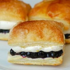 Blueberry Lemon Mini Puff Pastries - Easy to make using frozen puff pastry, these mini desserts are sure to be the hit of any party.