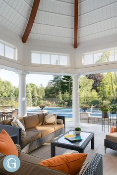 Modern and simple outdoor living space design for coastal homes. Design by Grande Interiors. Visit our website for more coastal home design inspo!