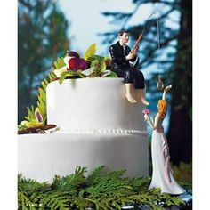 Thats how Chas asked me to marry him! Ring at end of fishing line in river. Wish we has this cake top for our wedding cake!