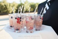Fizzy pink drinks with fresh fruit and chevron-striped straws. Ev… Fizzy pink drinks with fresh fruit and chevron-striped Summer Sangria, Pink Drinks, Wedding Catering, Catering Events, Thirsty Thursday, Signature Cocktail, Fresh Fruit, Nom Nom, Good Food
