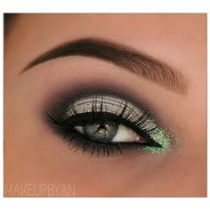 sparkly green shadow on the inner corner of the eye