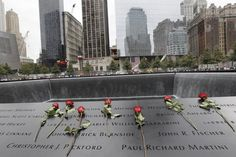Roses placed on the names of firefighters whose lives were lost on 9/11/01