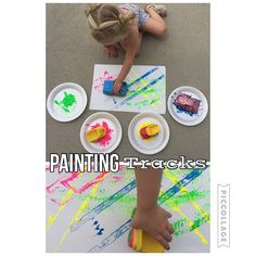 Painting Tracks {Breelie had a lot of fun driving her cars through paint!} #toddlercraft #toddlerplay #toddleractivities #toddleractivity #toddleractivityathome #toddlerplay #toddlerpaint #invitationtoplay