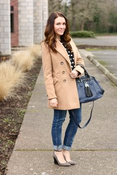 Blogger Sarah of Frills for Thrills looks stylish, yet casual in jeans and a beautiful camel jacket.