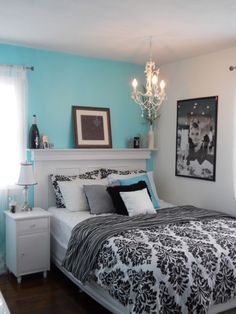 Turquoise accent wall behind bed and the rest a light to medium shade of grey. And I have black and white damask print bedding! Our furniture is black though.