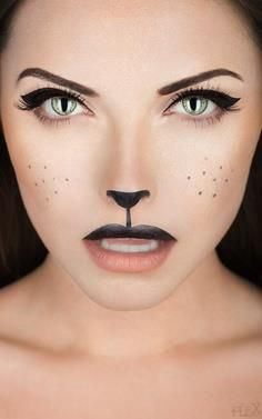 Simple cat makeup | obviously more effective because of the contact lenses, but with a few ruffs of fur drawn at the hairline it will work for the chorus