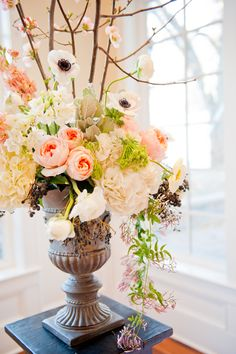 tall centre pieces - white and blue flowers - blue berrys - queen annes lace - dogwood - cherry blossom stems
