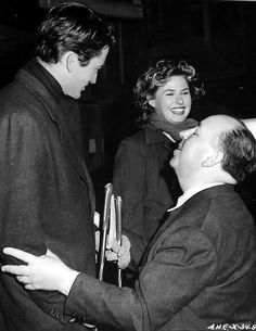 Gregory Peck, Ingrid Bergman and director Alfred Hitchcock on the set of 'Spellbound', 1945
