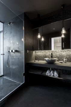 sleek bathroom in a renovated attic apartment by OOOOX