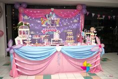 Backdrop & cake / candy table for a Little Pony & Friends theme birthday party. Design & setup by ParteeBoo - The Party Designers.