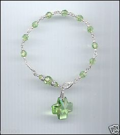 Exquisite silver rosary #bracelet w/ swarovski peridot green #crystals & #cross,  View more on the LINK: http://www.zeppy.io/product/gb/2/131760838341/