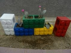 Recycled Cinder Blocks Into A Colorful Lego Planter by RockinPicks ||   Ingenious love it.  Lego personally makes me happy most likely because it reminds me of the time when i was happy as a child so i love when people bring the humble lego design into everyday items and this is so clever and imaginative