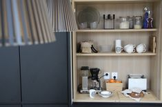 Here we store all the small appliences, cups and some food. One of the most busiest place in the kitchen and still works so well! White Kitchen Decor, Black Kitchens, Bathroom Medicine Cabinet, Floating Shelves, Cups, Store, Home Decor, Food, Mugs