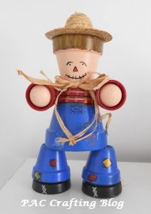 Clay Pot Scarecrow Craft Project for Fall and Halloween with step by step instructions. Totally cute!