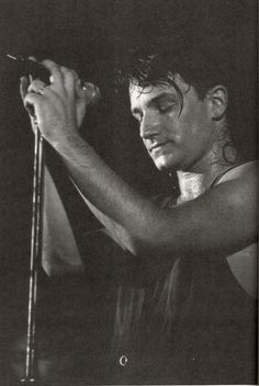 Bono on stage during (I guess) The Unforgettable Fire Tour 1984-85