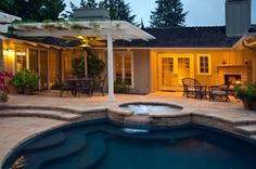 How is the pergola attached to the roof/bldg? We have a low eave too and you have a great solution! Thanks!