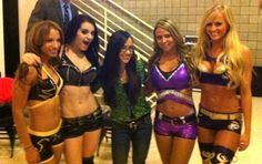 Aj Lee with the NXT Divas: (from left to right) Sasha Banks, Paige, Emma, and Summer Rae.
