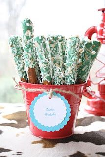 """""""cactus sticks"""" pretzel rods in green tinted white chocolate and coconut... adorable!!!  This page also has other western themed ideas."""