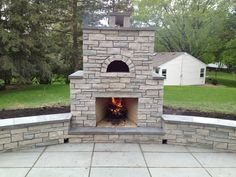 Outdoor Stone Fireplace With Pizza Oven