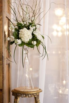 curly willow with white hydrangeas