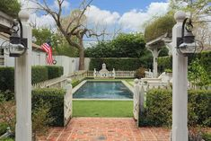 The back yard landscaping project was done by Lanson B. Jones, of Lanson Jones Landscape Architectural Firm in 2006. At that time, a pool was installed and additional brick patios and walks were created.