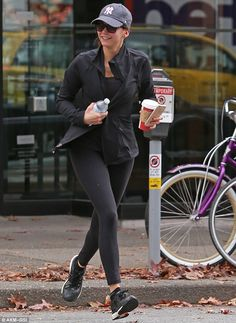 Sporty siren: The former Vampire Diaries beauty showcased her gym-honed thighs and calves in a pair of form-fitting black leggings, which she teamed with a low-cut sports vest and a track top