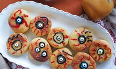 Halloween Homemade Treats for Kids-Pumpkin Donut Eyes with Dulce de Leche Cream.These pumpkin donut eyes are are deliciously sweet and wonderfully kid friendly, with their petite portions. The donuts are flavored with pumpkin puree, stuffed with dulce de leche vanilla pudding, and drizzled with a tangy blood orange glaze. If you want to get the kiddos involved, set out icing pens and let them decorate during the party!
