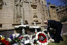 A member of the Armenian community lays a wreath at the memorial monument in Jerusalem's Old City on April 24, 2015.