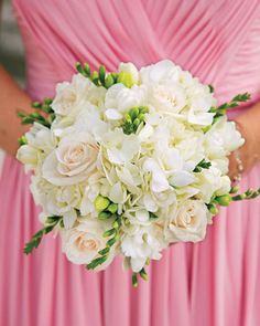 This white bridesmaid posy pops against a bright pink dress
