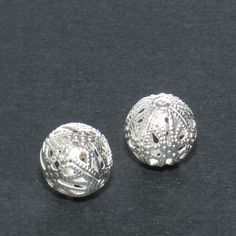 10 pcs 14mm Bright Silver Plated Filigree Bead Round Ball Spacer Link Connector A9-018. $1.50, via Etsy.