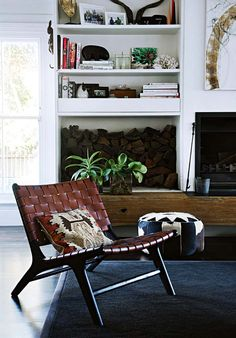 I really like the uniqueness of this fireplace - I like how it is different then the typical stand alone, or basic bookshelves on either side.  Love how the fireplace has one sided built ins (in different shapes) and the wood beam, just something a little different that looks authentic, fresh, and cool.